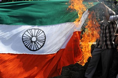 Indian police hunt Chennai youth who burnt the national