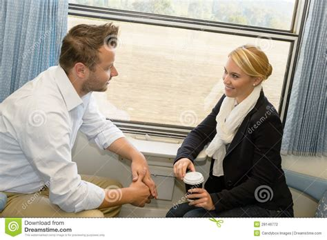 Woman And Man Traveling With Train Talking Stock